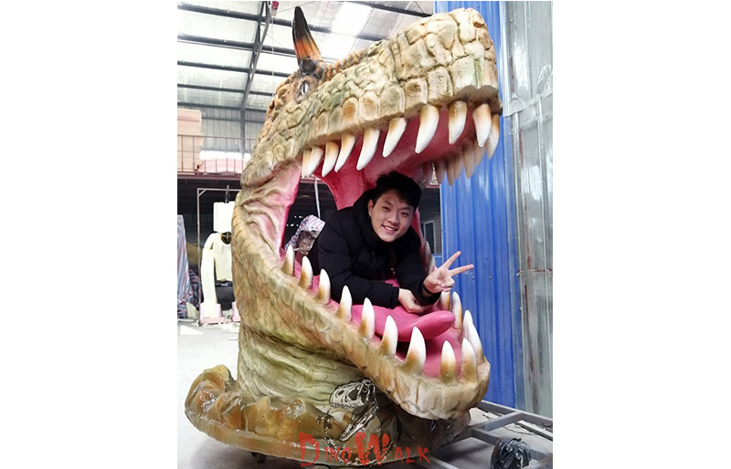 Gigantic fiberglass dinosaur's head for photo shooting