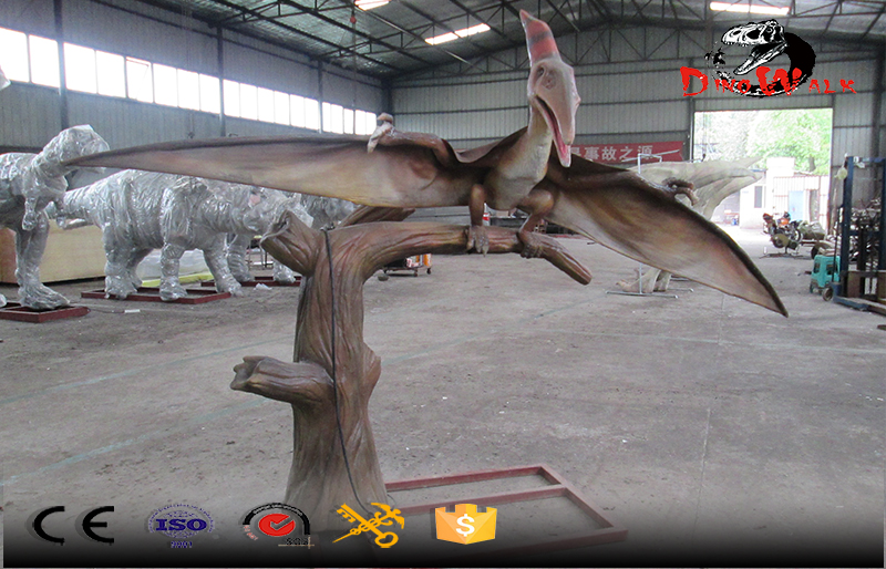 pterosaur animatronic dinosaur simulation standing on branch