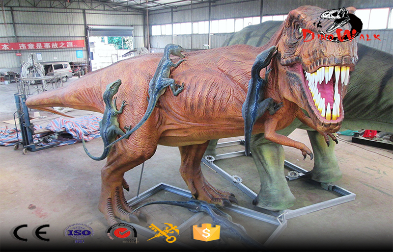huge animatronic T-rex fighting velociraptor for dinosaur park